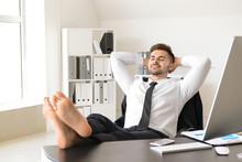Handsome Businessman Having Break During Work In Office