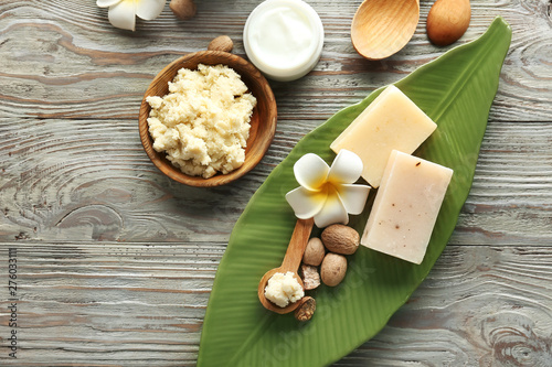 Composition with shea butter on wooden background - 276033111
