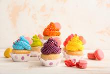 Sweet Tasty Cupcakes On Light Table