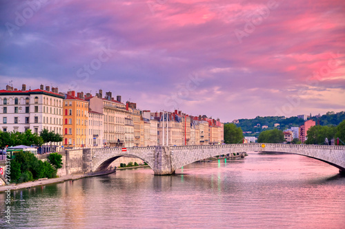 A view of Lyon, France along the Saône river at sunset.
