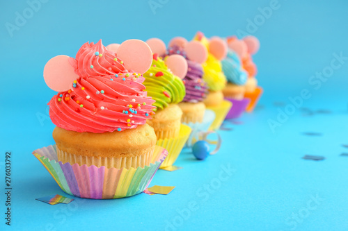 Sweet tasty Birthday cupcakes on color background Canvas Print