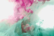 Ink paint drop in water background pink green colorful abstract texture on isolated on white background