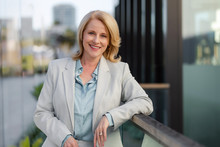 Attractive CEO Older Business Woman Executive Portrait Pose, Standing Outside Workplace Downtown