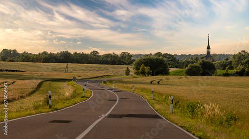 Montage in der Fensternische Beige Asphalt road leading to the German village