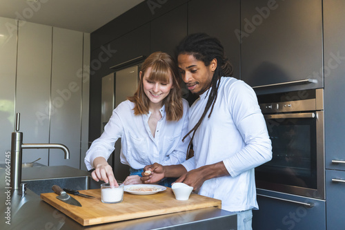 Fotografie, Obraz  Mixed Race Couple Cooking Together in the Kitchen.
