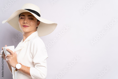Portrait of a woman with a cup of coffee isolated over background Fototapet