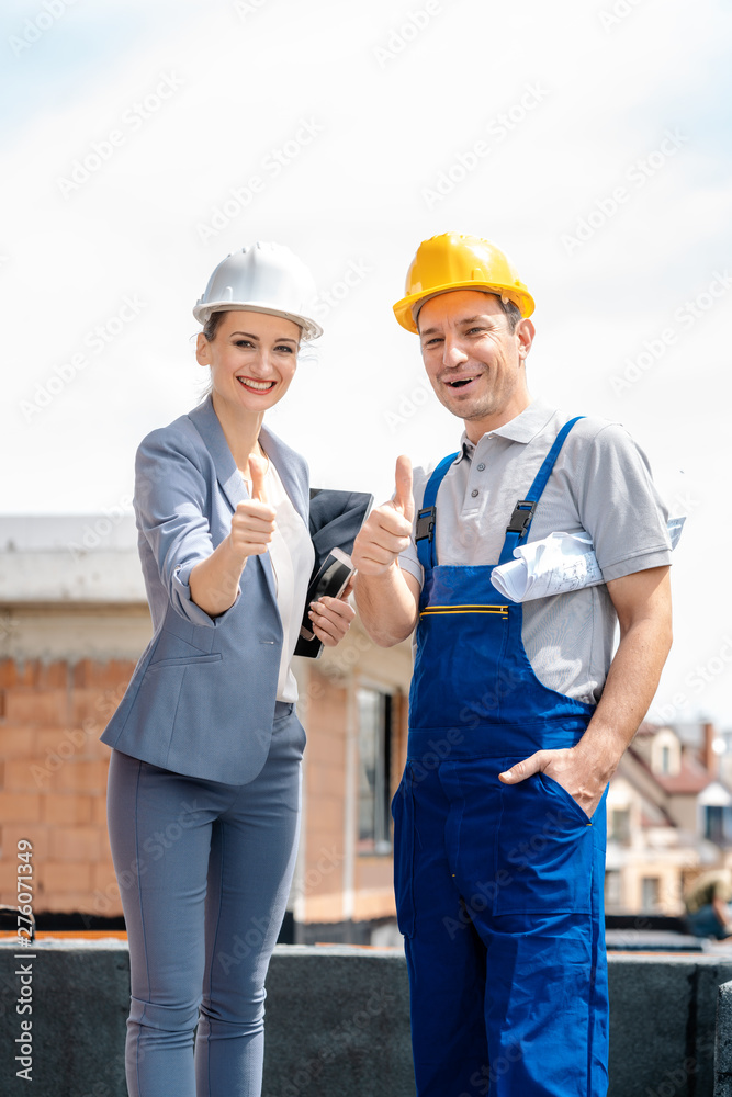 Fototapety, obrazy: Architect and Construction worker on site giving thumbs-up
