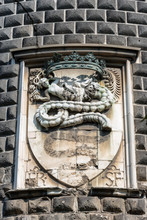 Detail Of The Sforza Castle (Castello Sforzesco) With The Coat Of Arms Of The Noble Family Of The Visconti With A Snake That Swallows A Human (Biscione). Milan, Lombardy, Italy, Europe