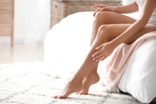 Young Woman With Beautiful Legs In Bedroom