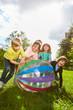 Leinwandbild Motiv Gruppe Kinder spielt ausgelassen mit einem Ball