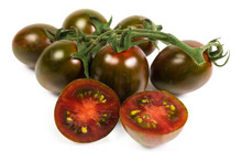 Cherry Tomato Kumato Cut In Half Against Of Tomato Cluster