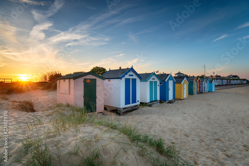 Fotomural Sunset over a row of beach huts at Southwold