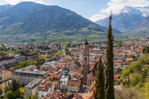Foto auf Leinwand Cappuccino Panorama view on skyline of main District of City Meran with Church, Vegetation and Mountains. Merano. Province Bolzano, South Tyrol, Italy. Europe.