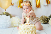 Little Baby Girl Eating Cake O...