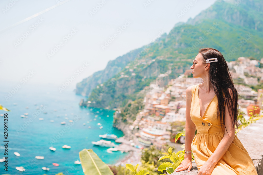 Fototapety, obrazy: Summer holiday in Italy. Young woman in Positano village on the background, Amalfi Coast, Italy