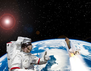 Astronaut and rocket above the earth. Space concept. The elements of this image furnished by NASA.