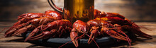 Panoramic Shot Of Beer Glass On Plate With Red Lobsters At Wooden Surface