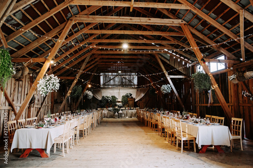 Interior of an old wooden hall with decorated tables. Poster Mural XXL