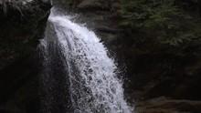 Rushing Waterfall Coming Down Mountain Tilt Slow Motion