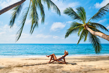 Young Beautiful Woman Sunbathe And Relax On Tropical Beach