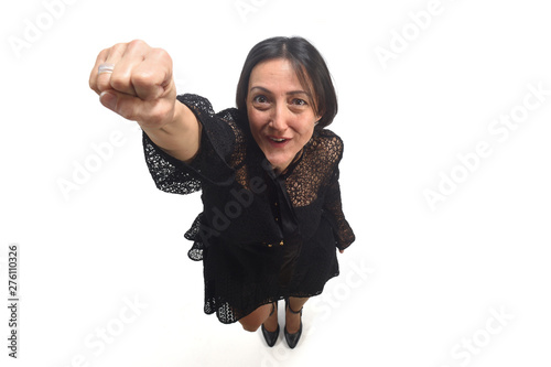 Photo  superwoman with her fist as if she were flying