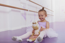 Little Beautiful Happy Girl Laughing, Having Fun At Ballet School, Copy Space. Adorable Little Ballerina Laughing Excitedly, Resting After Ballet Lesson
