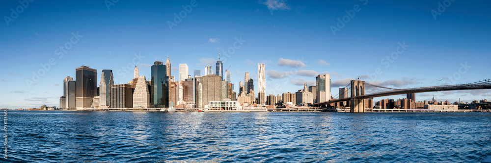 Fototapety, obrazy: Manhattan skyline panorama with blue sky as background image