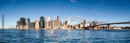 Fototapeta Manhattan skyline panorama with blue sky as background image obraz
