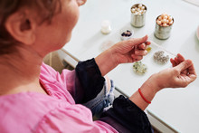 Senior Woman Making Bracelets ...