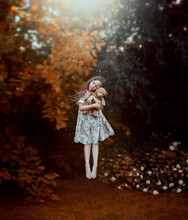 Dream Of Cute Girl With Flying Hair Hovers Above Ground With Teddy Bear In Hands. Child In Long Light Dress With Floral Pattern Levitates In Dreams And Hugs Toy, Creative Magical Photo In Air