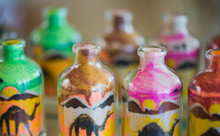 Bottles With Multicolor Sand Pictures Inside On Egyptian Market Shelfs Closeup