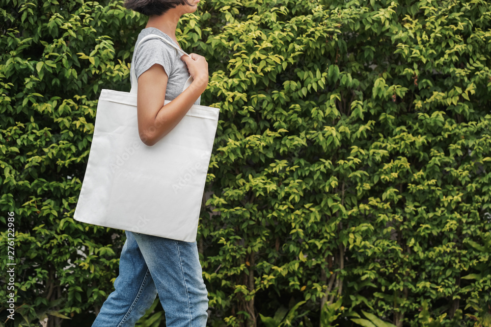 Fototapety, obrazy: hipster woman with white cotton bag at park