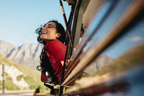 Woman having fun on car ride - 276131954