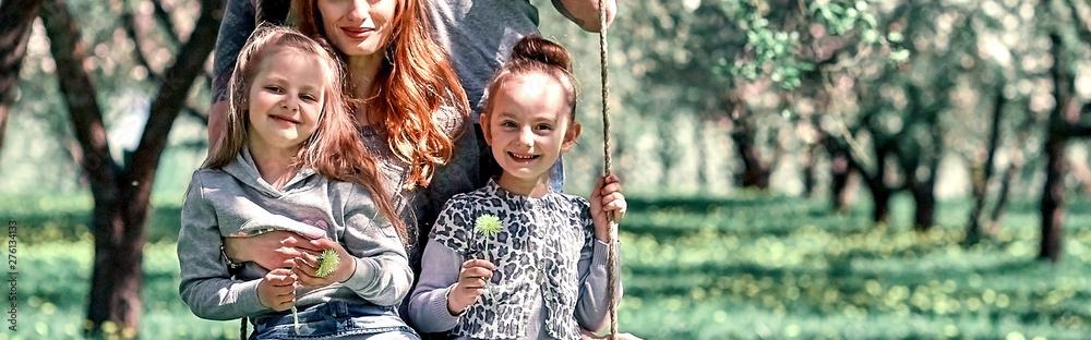 Fototapety, obrazy: happy family is having fun in their garden.