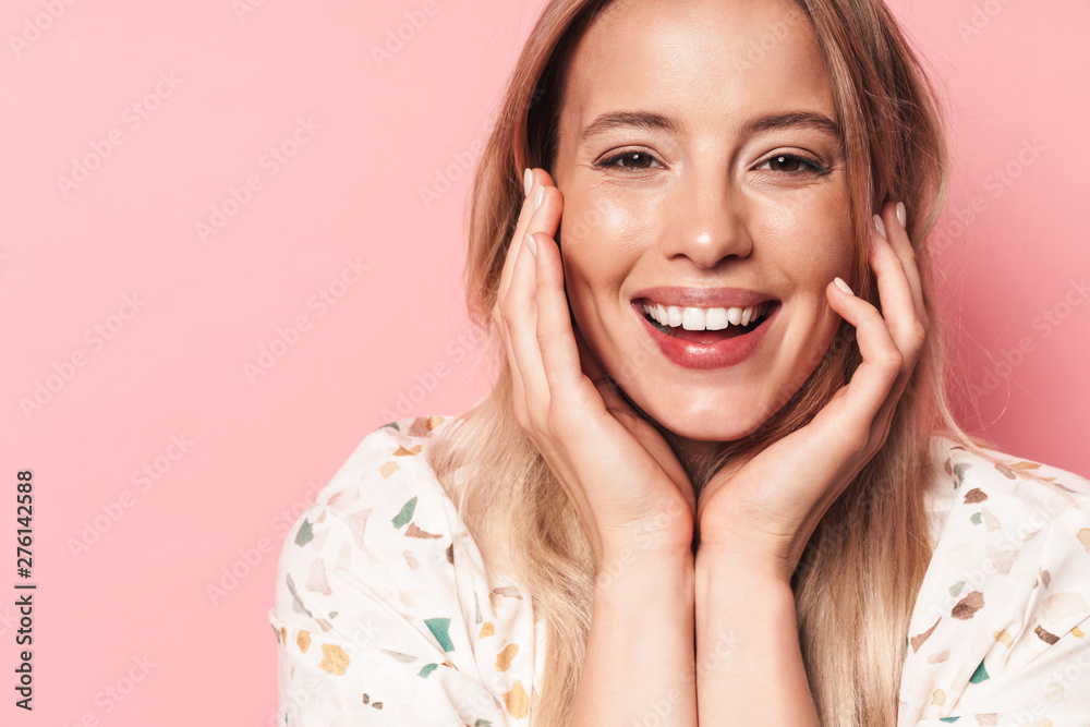 Fototapety, obrazy: Beautiful smiling blonde woman posing isolated over pink wall background.