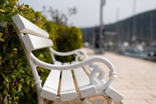 White Wooden Bench In The Marina Of Cres