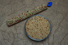Food For Wavy Parrot White, Yellow, Black And Red Millet Texture