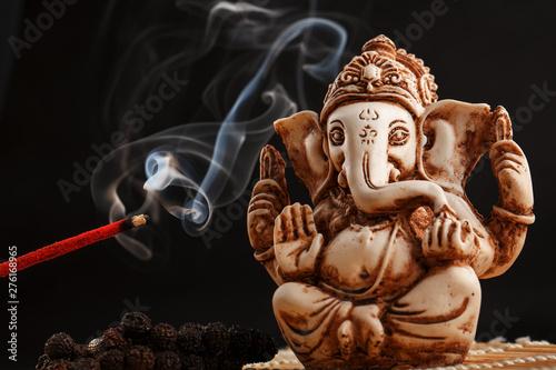 Leinwand Poster Hindu god Ganesh on a black background
