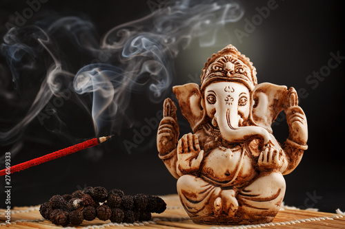 Hindu god Ganesh on a black background Canvas Print