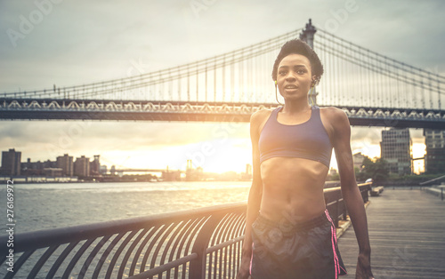 Athlete woman training in the morning at sunrise in New york city, Brooklyn in t Canvas Print