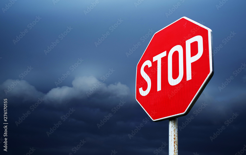 Fototapeta Conceptual stop sign with stormy background. Warning, caution and danger sign