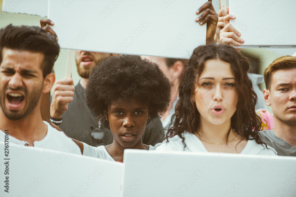 Fototapety, obrazy: Public demonstration on the street against social problems and human rights. Group of multiethnic people making public protest