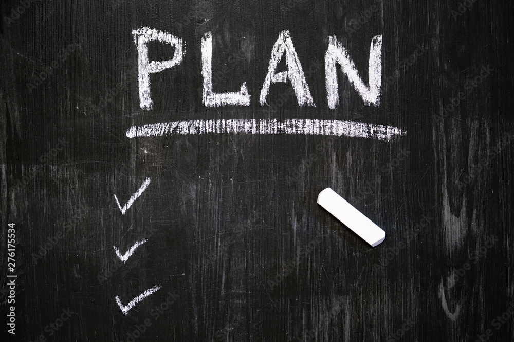 Fototapety, obrazy: Plan word handwritten with chalk on blackboard. Black wood background and a list of scheduled tasks to do, top view. Time management, self organization concept.