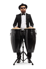 Male Musician Playing On Conga Drums