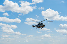 Flying Military Transport Helicopter Special For Army Soldier In Fight War. Military Soldier Volant In Transport Helicopter Above Clean Blue Sky. Helicopter Is Military Transport To Army Soldier