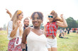 Multiethnic group of young people having fun at music festival