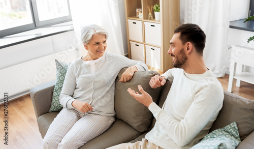 Poster Ouest sauvage family, generation and people concept - happy smiling senior mother talking to adult son at home