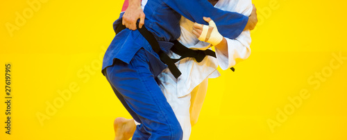 Two judo fighters in white and blue uniform. Canvas Print