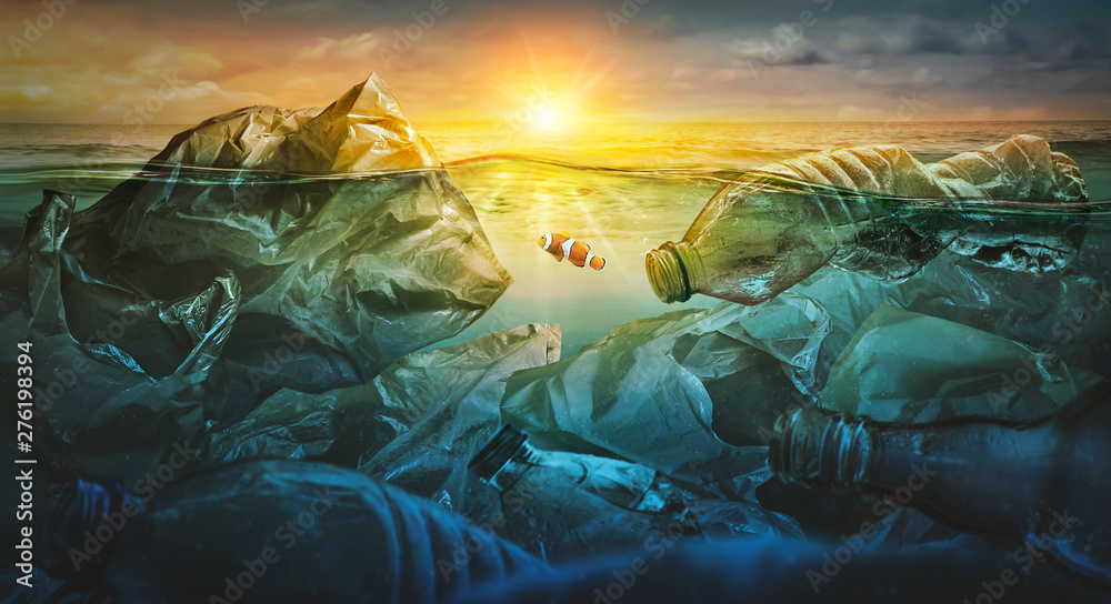 Fototapety, obrazy: Fish swims among plastic bag ocean pollution. Environment concept