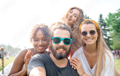 Friends on selfie photo from summer music festival - 276202383